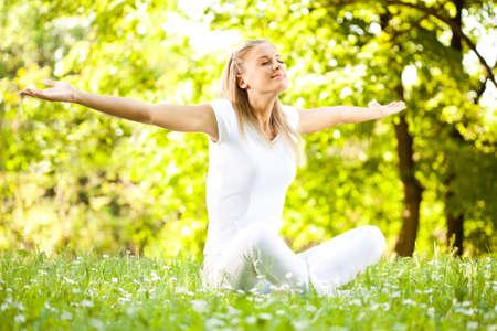 Young woman enjoying nature in park Фото со стока