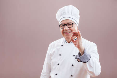 authoritative: Portrait of restaurants chef who is satisfied with his meal Stock Photo
