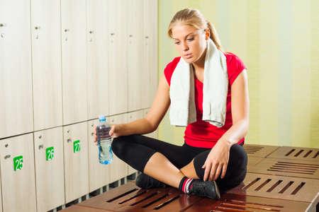 locker room: Tired girl in locker room after workout