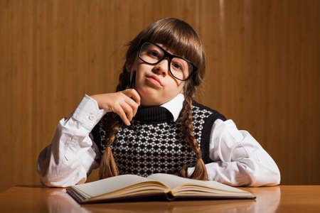 novel: Little girl writing a novel