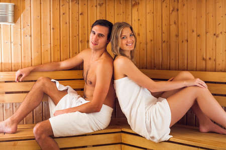 perspire: Young happy couple enjoying a sauna together Stock Photo