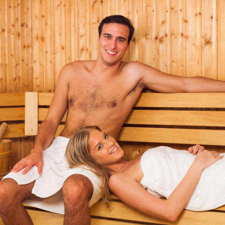 sauna: Young happy couple enjoying a sauna together Stock Photo