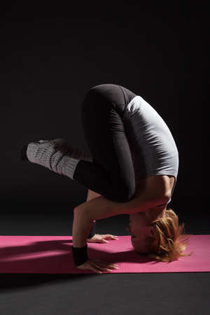 headstand: Young woman practicing yoga, Sirsasana  Supported Headstand pose