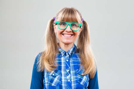 nerdy: Studio shot portrait of happy nerdy woman