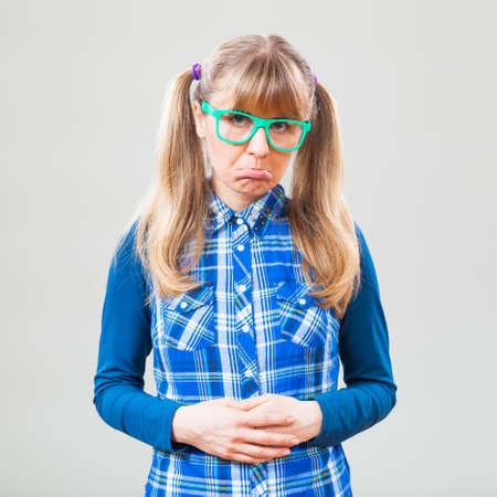 nerdy: Studio shot portrait of sad nerdy woman