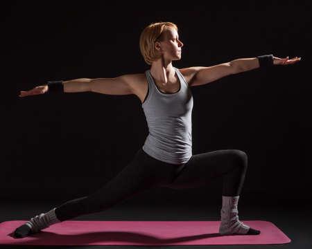 virabhadrasana: Young woman practicing yoga, Virabhadrasana  Warrior pose Stock Photo