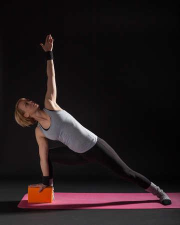 trikonasana: Young woman practicing yoga, Trikonasana  Bikram triangle right
