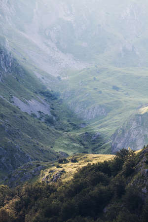 extreme terrain: Sunbeam on cliff in mountain, Dinaric Alps, Europe.