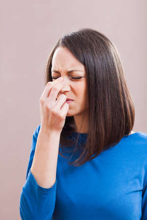 sinusitis: Portrait of young woman who is having pain in her sinus. Stock Photo
