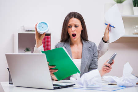 too much work: Young businesswoman is angry because she has too much work. Stock Photo