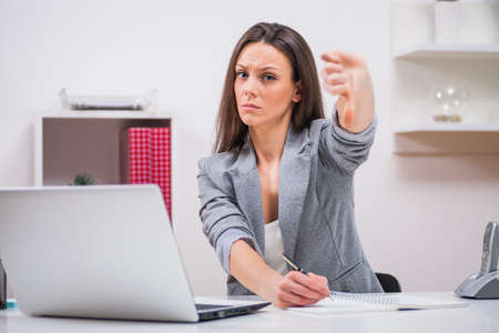 Young businesswoman is frustrated because of business failure. Stock Photo