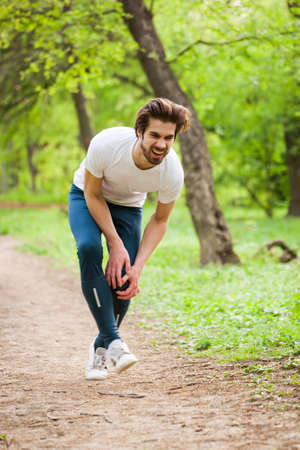 Young man got injured while jogging in park.