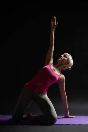 Woman exercising pilates. Mermaid exercise. 写真素材 - 119544429