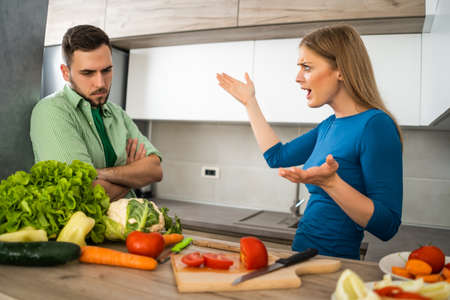 Husband does not like meal that his wife is preparing.