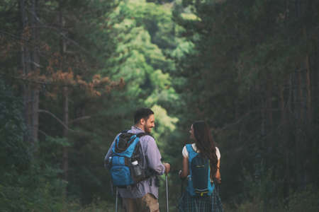 Happy couple is hiking in forest. 版權商用圖片