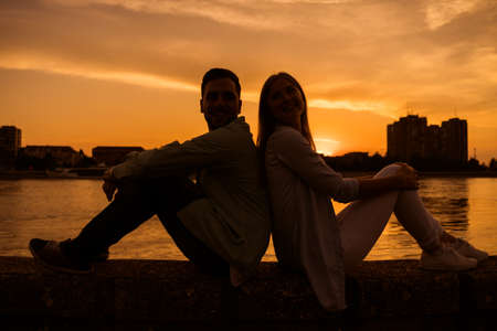 Happy couple is enjoying sunset in the city.