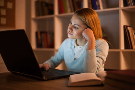 Student learning at home. Watching online course.