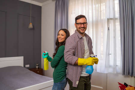 Young happy couple is ready for cleaning their apartment.