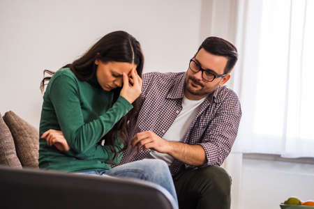 Woman is sad, her man is consoling her.
