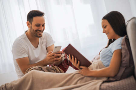 Young happy couple in bed in the morning.
