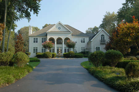 suburban neighborhood: A large elegant home in the suburbs in the northeastern part of the United States. Stock Photo