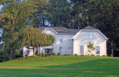 A large white colonial style home.