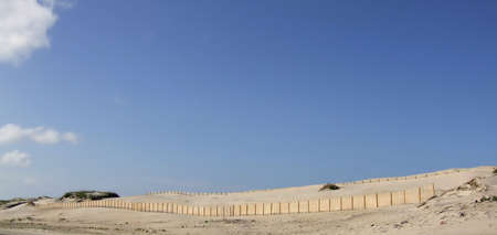 Sand dunes along North Carolina Route 12, on Hatteras Island on the Outerbanks of North Carolina.