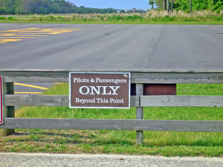 Sign stating that pilots and passengers only beyond this point.