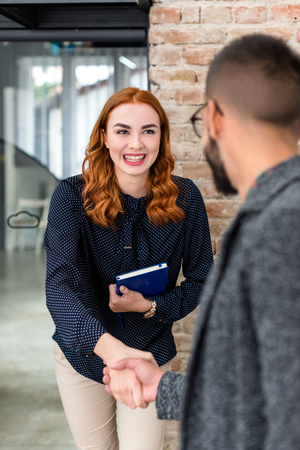 Woman disarming human resource manager with a smile at a job interview