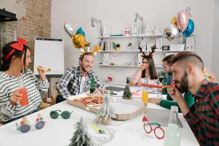 Employees organising a little christmas celebration