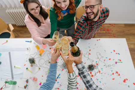 Employees toasting at the office party