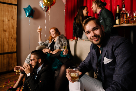 Young man partying with good friends Stock Photo