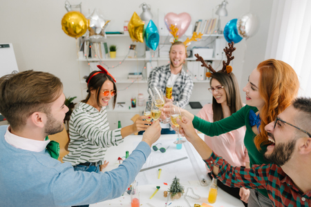 Employees toasting at office party Stock Photo