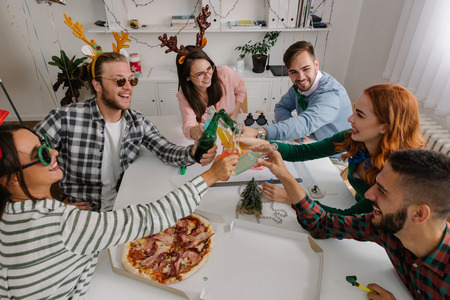 Young coworkers toasting together Stock Photo