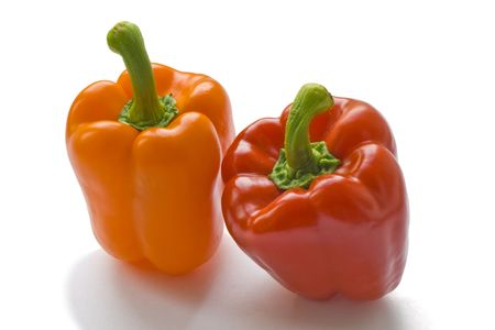 Isolated image of red and yellow pepper on white background Stock Photo