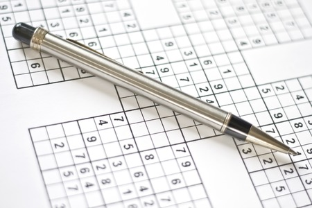 sudoku: Sudoku puzzle and mechanical pen. lazy sunday