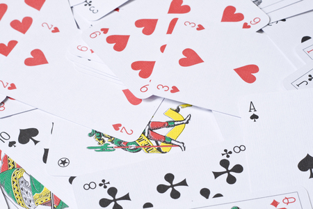 Set of playing cards are scattered on a table