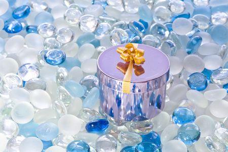 Shiny fancy box on white and blue glass balls Stock Photo