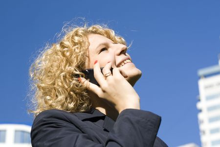 The business woman talks by a mobile phone Stock Photo