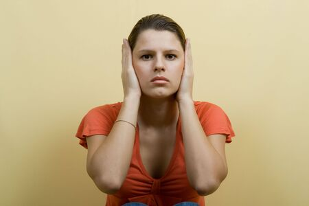 woman closes ears hands Stock Photo - 2375812