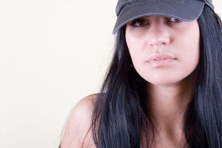 blackhair women in  cap. studio shot.