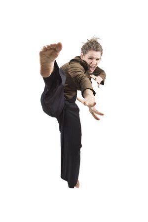 Funny karate girl on white background Stock Photo