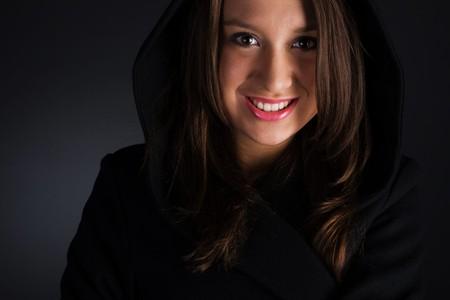 woman in coat on dark background