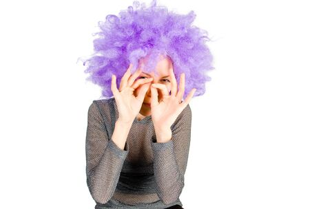 artificial hair: Smiling woman in violet wig on white background Stock Photo