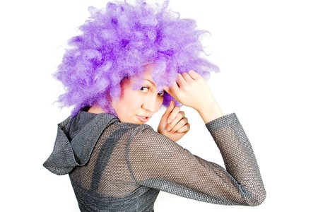 Young woman in violet wig on white background Stock Photo