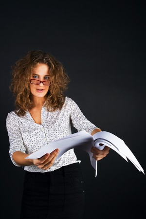 business women with documents on black background