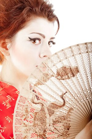 beautiful japanese woman in kimono with a fan on white background photo