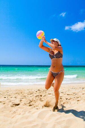 Young girl jump on sea beach