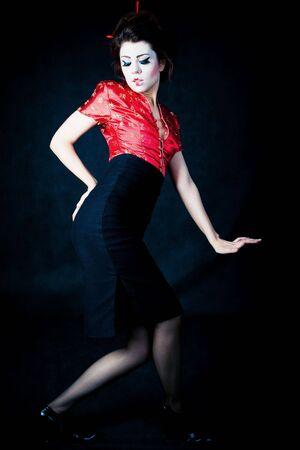 beautiful geisha-styled women posing on dark background Stock Photo