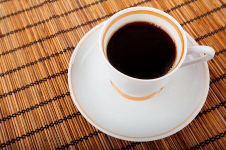 coffee cup on bamboo rug